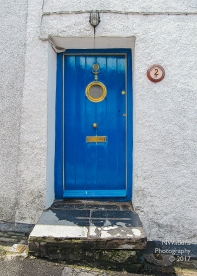 blue door with porthole