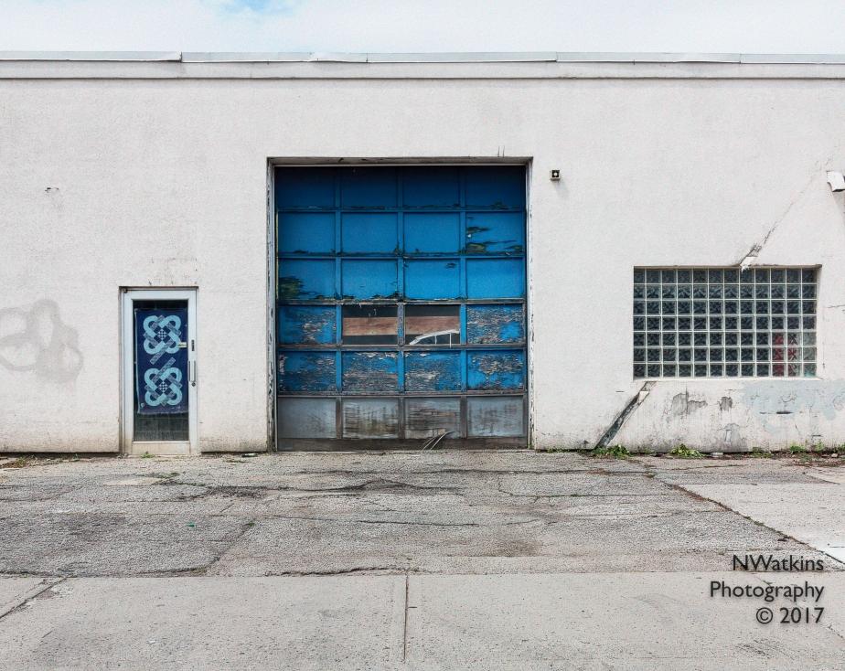 blue garage door cw